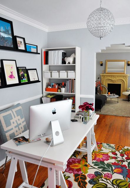 very calm home office design with colorful carpet