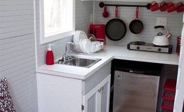 red and white colored small kitchen design