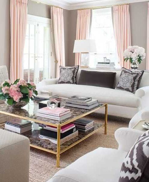 white living room with pink curtains