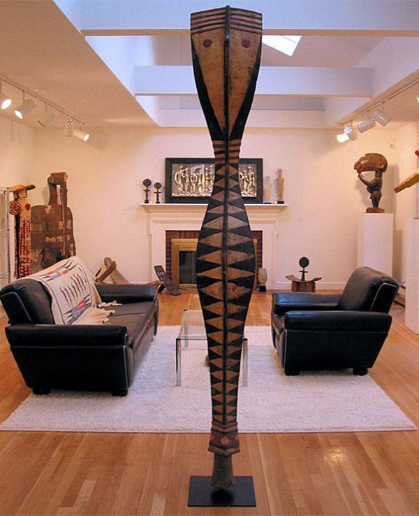 Stylish living room decor with creative sculpture