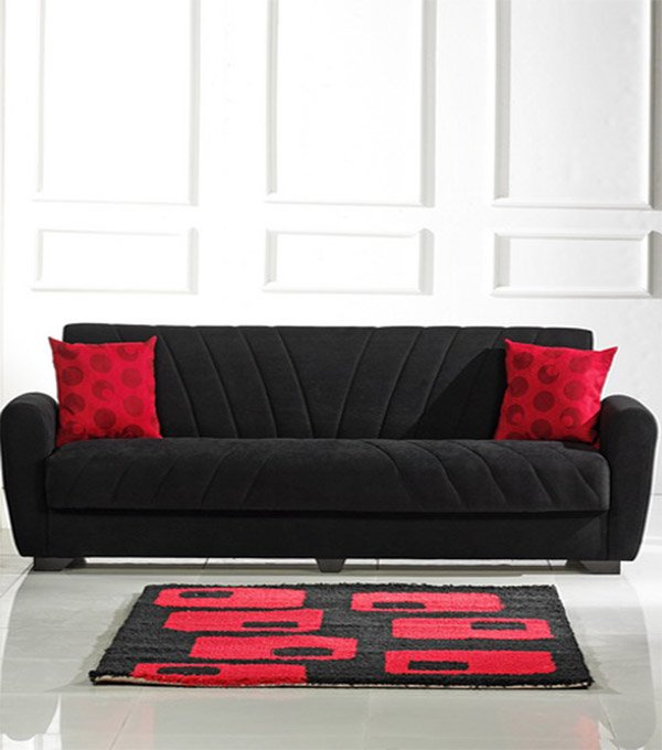 black furniture for living room with red pillows