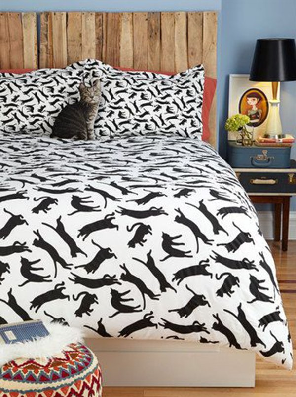 lady bedroom ideas with cat bedspread