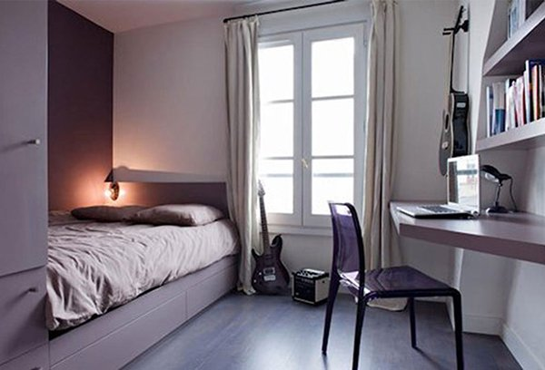 small bedroom designed with purple tones