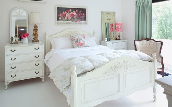 white bedroom decorated with antique furniture