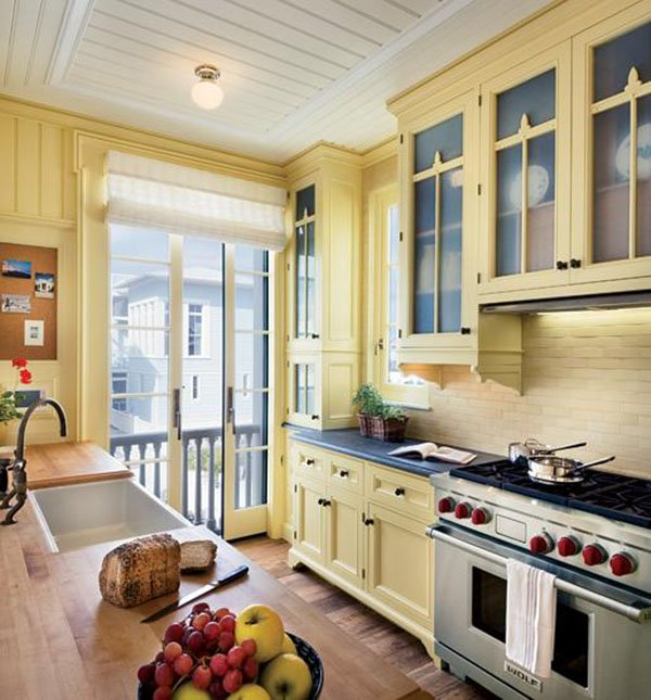 soft yellow colored kitchen cabinets
