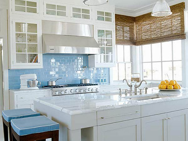 stylish white kitchen with blue backsplash
